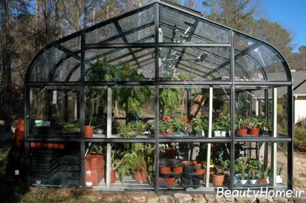 انواع گلخانه زیبا با پوشش شیشه ایی