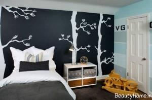 نقاشی شاخه های درخت بر روی دیوار