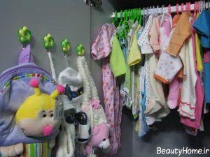چیدمان لباس های نوزاد