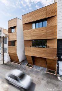 نمای ساختمان سه طبقه با آجر