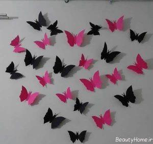 تزیین دیوار با پروانه های مشکی و صورتی