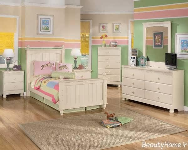 دکوراسیون سفید و سبز اتاق خواب کودک