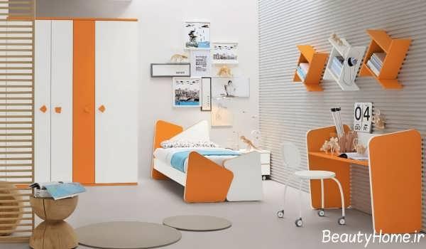 دکوراسیون سفید و نارنجی اتاق خواب کودک
