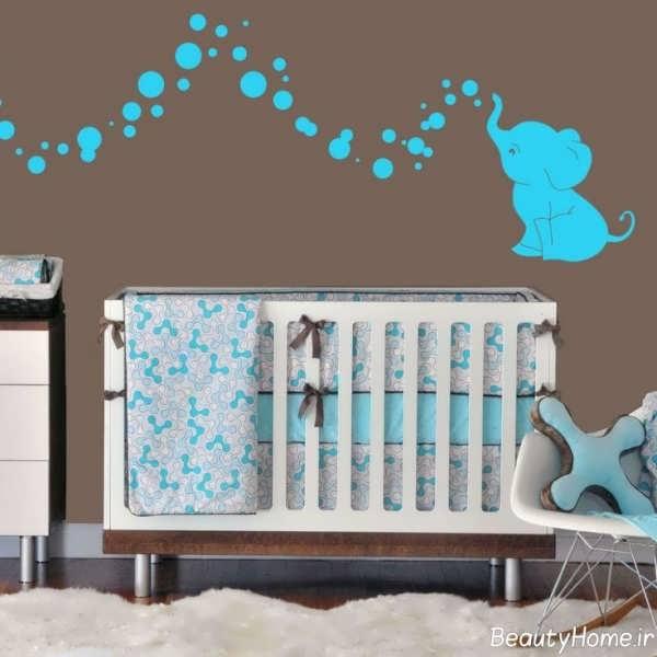 دکوراسیون آبی قهوه ای اتاق نوزاد پسر