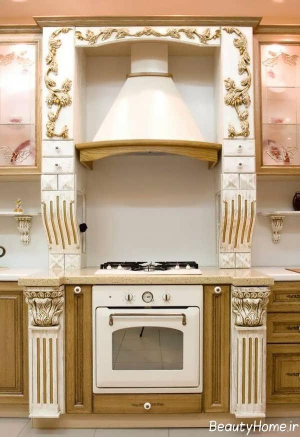 مدل کابینت طلایی سفید آشپزخانه