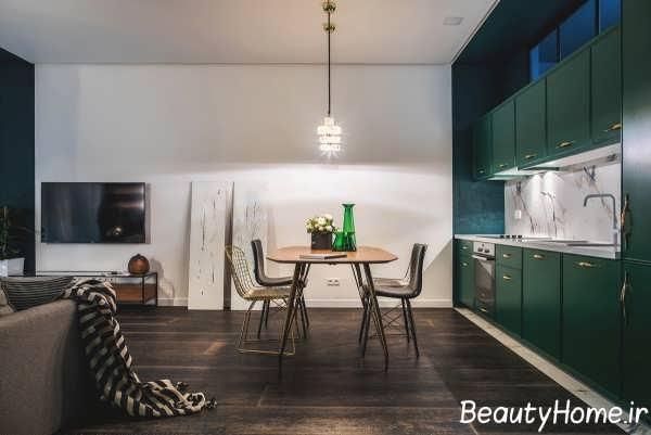 طراحی اتاق نشیمن با رنگ طلایی و سبز