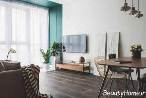 طراحی زیبای اتاق نشیمن با تم سبز