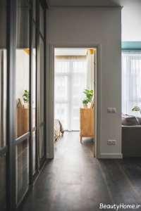طراحی متفاوت اتاق پذیرایی با تم طلایی و سبز