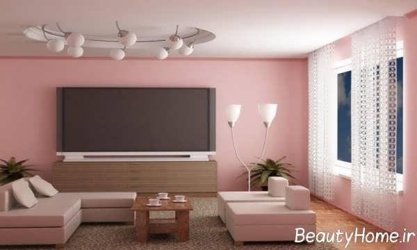 طراحی عالی دیوار پشت تلویزیون با تم صورتی