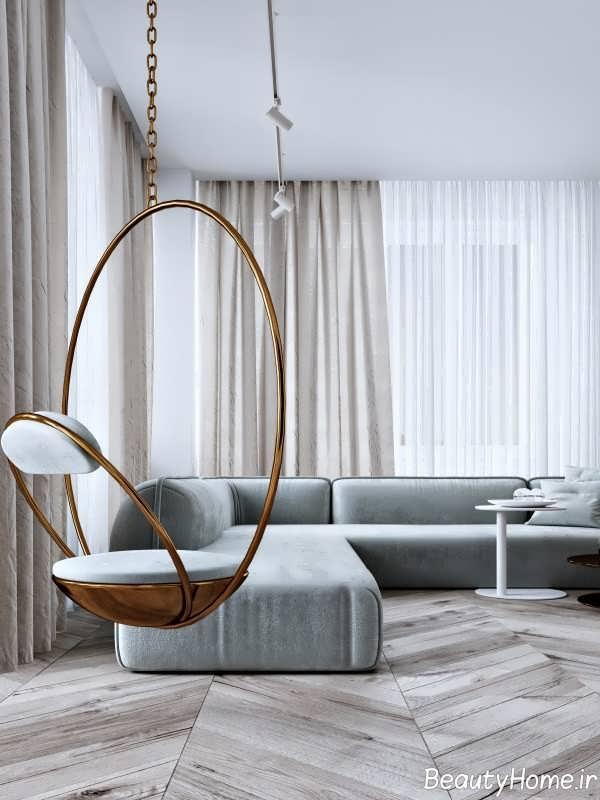 دکوراسیون زیبای اتاق پذیرایی با تم طلایی