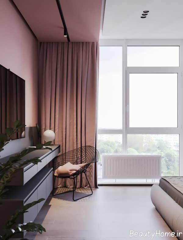 طراحی زیبای اتاق نشیمن با تم صورتی و خاکستری