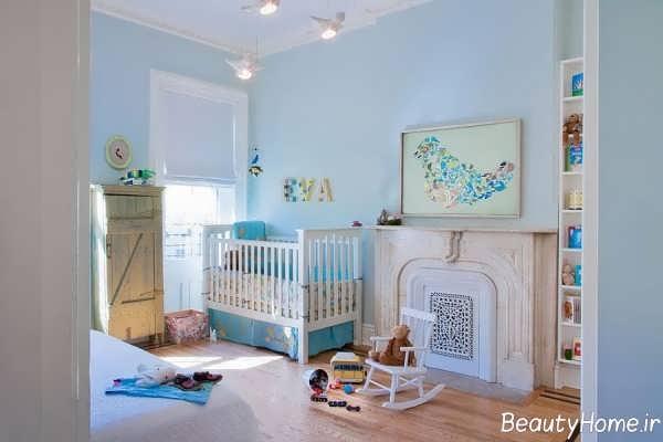 دکوراسیون سفید و آبی اتاق نوزاد