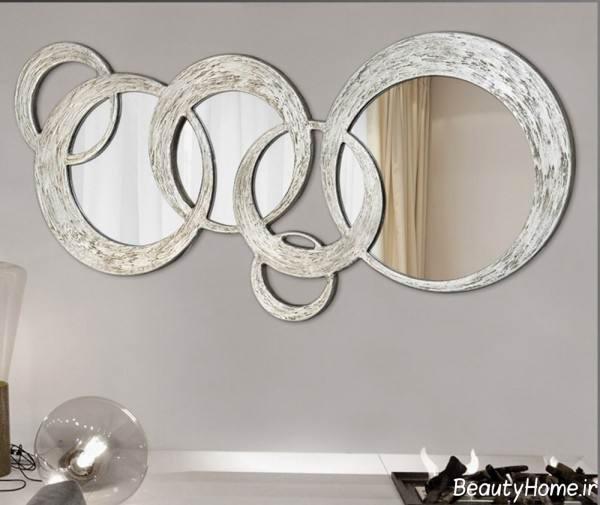 تزیین دیوار پذیرایی با آینه