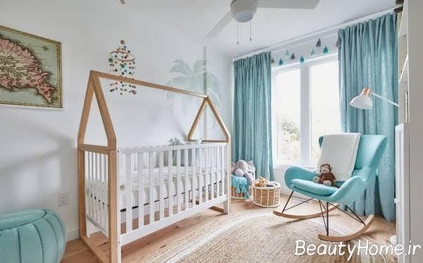 دکوراسیون سفید و آبی برای اتاق نوزاد